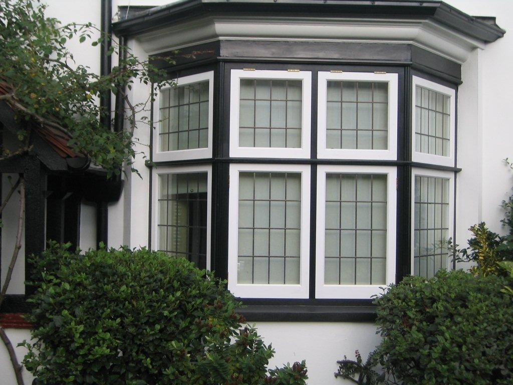 Black and white casement wood window