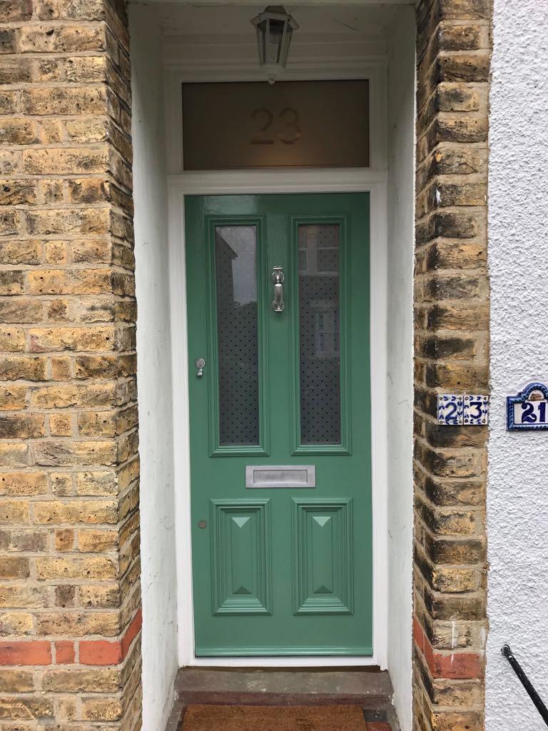 Green front door - Timber Windows London